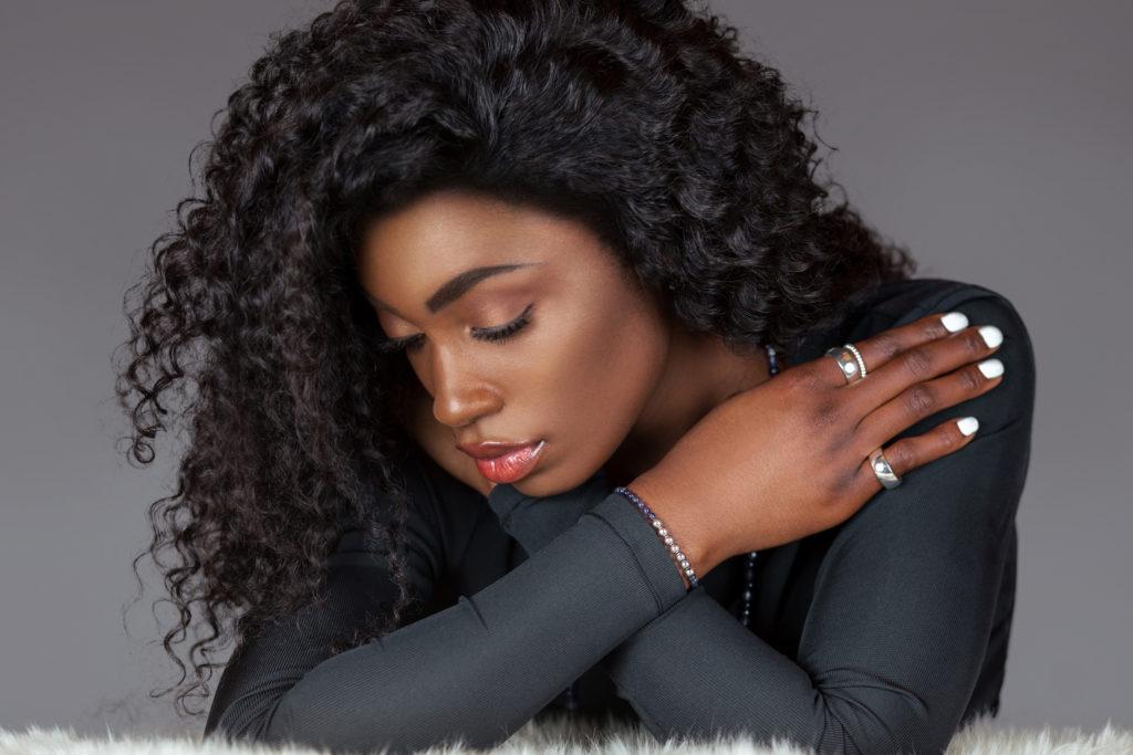 Serene Black Woman in Black Long Sleeve