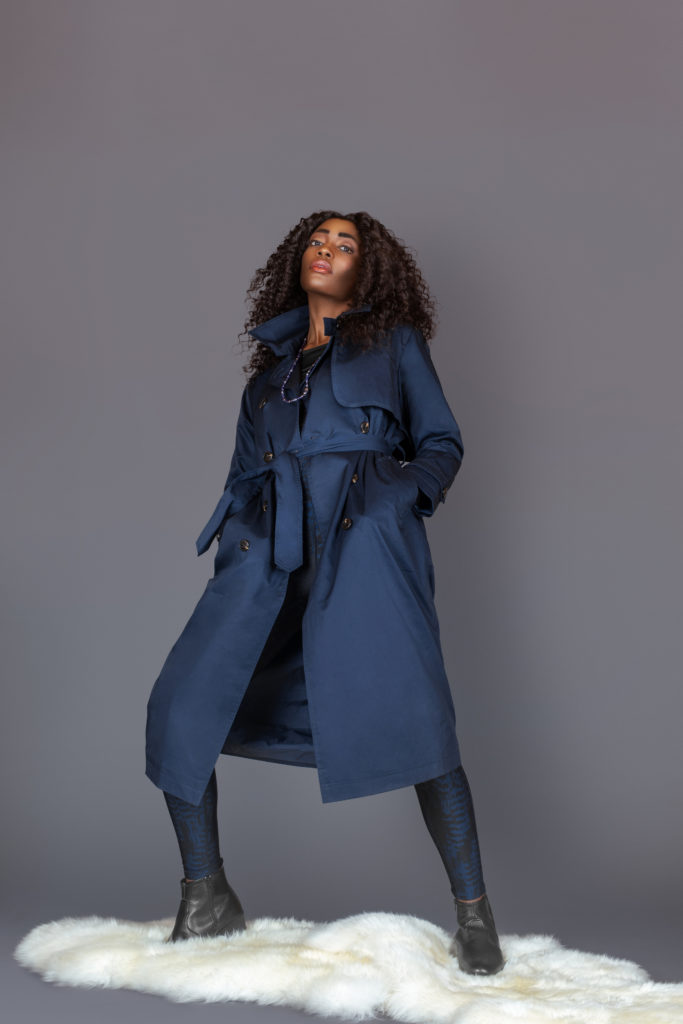 Tall Black Woman in Blue Trench Coat