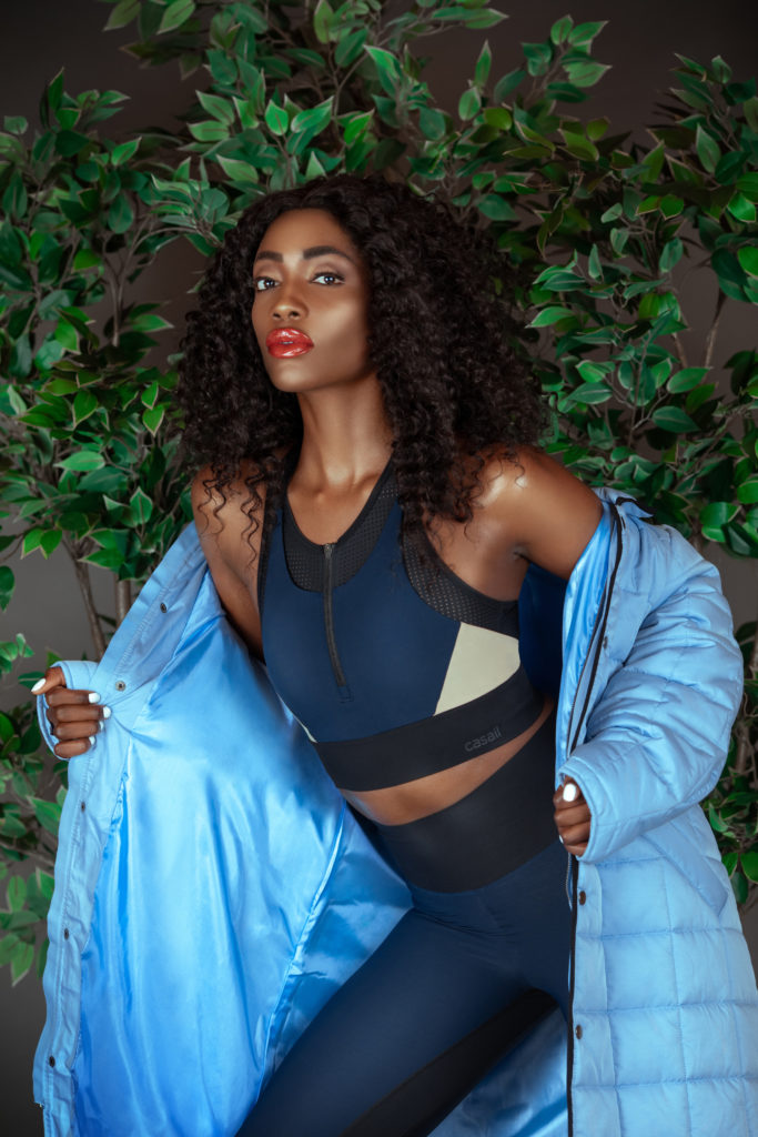 Sensual Black Woman in Fitness Outfit & Blue Coat